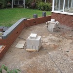 Clearance and retaining wall